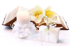 First holy communion. Or confirmation - candle, open bible and small present Stock Images
