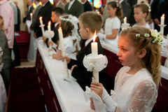 First Holy Communion. Traditional catholic event in Poland - First Holy Communion for eight year old children Stock Photos