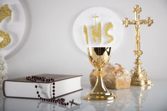 First Holy Communion. Catholic religion theme. Crucifix, Bible, bread isolated on white table and white background Stock Photo
