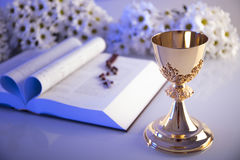 First Holy Communion. Catholic religion theme. Crucifix, Bible, bread isolated on white table and white background Royalty Free Stock Images
