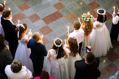 First holy communion in church, many children. First holy communion in church, many little children Stock Images