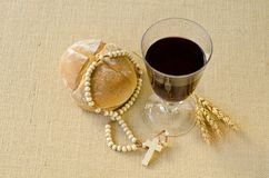 First Holy Communion. Composition on beige sackcloth background Stock Photos