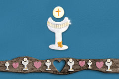 First Holy Communion invitations. Chalice on blue background with empty space for text and photos Stock Photography