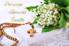 The first holy communion in polish with rosary and flowers Stock Images