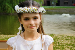 First holy communion. Portrait of a girl  with a daisy chain on the day of her first holy communion Royalty Free Stock Photography