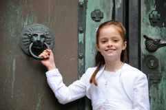 First  holy communion. Portrait of a girl in front of the church door  on the day of first holy communion Stock Photography