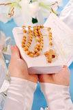 First holy communion-prayer book and rosary Stock Photography