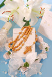 First holy communion-prayer book and rosary. Prayer book and wooden rosary for first holy communion on blue background Stock Image