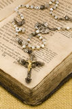 Holy Communion. First Holy Communion Rosary over an old religious book Stock Images