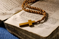 Holy Communion. First Holy Communion Rosary over an old religious book Stock Photos