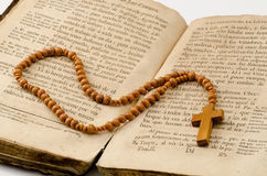 Holy Communion. First Holy Communion Rosary over an old religious book Stock Photography
