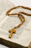 Holy Communion. First Holy Communion Rosary over an old religious book Stock Photo