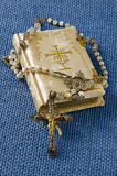 Holy Communion. First Holy Communion Rosary and Religious Book on blue background Stock Photo