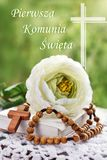 First Holy Communion still life with rosary and polish text Royalty Free Stock Image