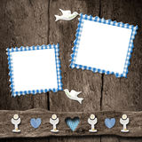 First Holy Communion, two blue photo frames. First Holy Communion childlike invitations, two empty blue photo frames on wooden rustic background Stock Image
