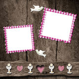 First Holy Communion two photo frames. First Holy Communion childlike invitations, two empty photo frames on wooden rustic background Stock Photo