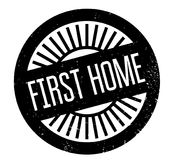First Home rubber stamp. Grunge design with dust scratches. Effects can be easily removed for a clean, crisp look. Color is easily changed Stock Photo
