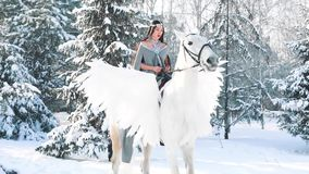 First horse riding, sweet cute girl with long black straight hair puts on white horse with wings, pegasus strides