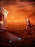 First Human On Mars - Digital Painting. Digital painting of the first person to stand on Mars watching a Martian sunrise Royalty Free Stock Image