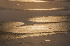 First the ice at sunset. Reflected rays of the setting sun in the ice surface Stock Photo