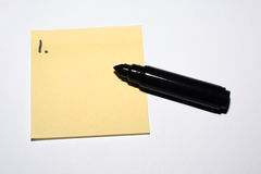 First idea - sticky note and pen Stock Photo