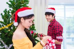 First impression of man to woman who prepare to decorating Chris. First impression of men to women who prepare to decorating Christmas tree in New year festival Stock Image