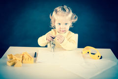 First Keys. Baby Girl as a Architect Royalty Free Stock Photography