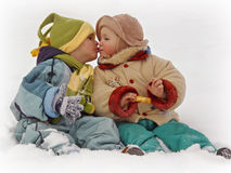 First kiss 2. 2 cute little kids kissing in snow Royalty Free Stock Photography