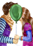 First kiss. Boy and girl kissing behind balloon Stock Photo