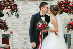 First kiss of just married after the ceremony Royalty Free Stock Photo
