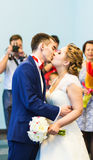 First kiss of newly married couple Stock Images