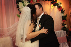 First kiss of newlyweds Stock Photography