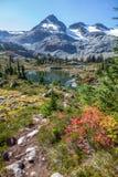 First lake views,  Semaphore Lakes Trail, Pemberton, Canada. After cresting a ridge, the stony Semaphone Lakes trail reveals the first views of alpine lakes and Stock Photo