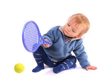 First lesson of tennis. Boy on white stock images