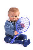 First lesson of tennis. Boy on white Royalty Free Stock Images