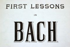 First Lessons in Bach. Old print of front of Bach sheet music: First Lessons in Bach Stock Photos