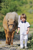 First lessons of horseback riding Royalty Free Stock Image