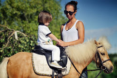 First lessons of horseback riding Royalty Free Stock Photos