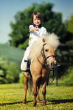 First lessons of horseback riding Stock Photo