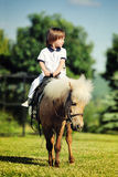 First lessons of horseback riding Royalty Free Stock Photo