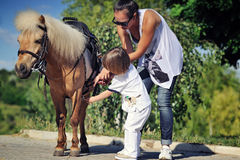 First lessons of horseback riding Royalty Free Stock Photography