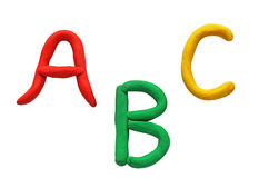 The first letters of the Latin alphabet fashioned from colored plasticine Stock Photography