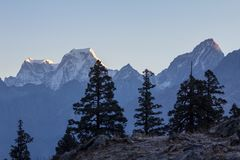 First light of dawn reaches Snowy peaks. Garhwal Himalaya, Indi stock photography