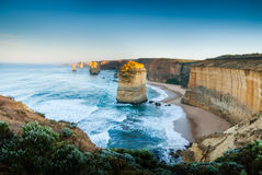 First light hits the Twelve Apostles. First dawn rays strike the tops of the the landmark Twelve Apostles sea stacks along the Great Ocean Road in Victoria Royalty Free Stock Image