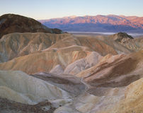 First Light on the Panamint Range from the Golden Canyon badlands, Death Valley National Park, California stock photos
