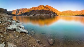 Lucky Peak State Park at sunrise in Idaho, USA. The first light of the sun hits the mountains in Lucky Peak State Park, right outside Boise, Idaho stock image