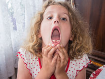 First lost tooth. Excited and smiling showing first lost baby tooth Royalty Free Stock Photo