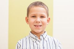 First lost tooth. Portrait of young boy  who lost his milk teeth Royalty Free Stock Photo