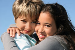 First love. Cute girl hugging her mother on a sunny day Stock Photo