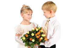 The first love. Beautiful couple with flowers Royalty Free Stock Photo
